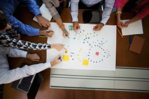Business people drawing plan during meeting --- Image by © Blue Images/Corbis