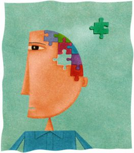 A man with a puzzle on his head and a missing piece --- Image by © ImageZoo/Corbis